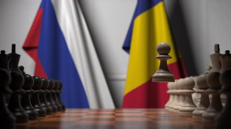 rumena : Flags of Russia and Romania behind pawns on the chessboard. Chess game or political rivalry related 3D animation
