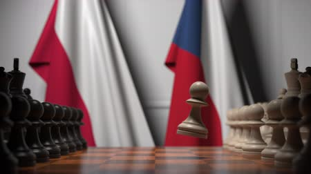 schachbrett : Flags of Poland and the Czech Republic behind pawns on the chessboard. Chess game or political rivalry related 3D animation