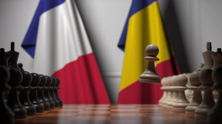romeno : Flags of France and Romania behind pawns on the chessboard. Chess game or political rivalry related 3D animation