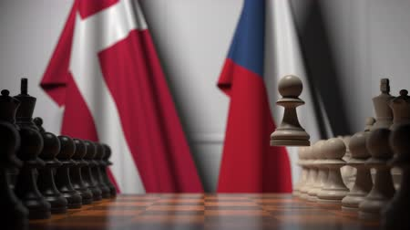 deense dog : Flags of Denmark and the Czech Republic behind pawns on the chessboard. Chess game or political rivalry related 3D animation Stockvideo