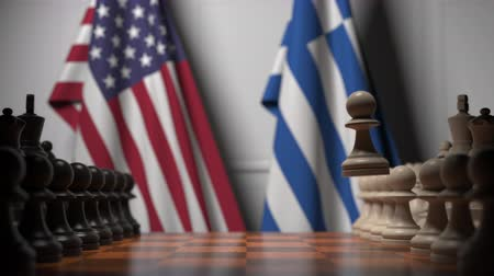 greece flag : Flags of USA and Greece behind pawns on the chessboard. Chess game or political rivalry related 3D animation