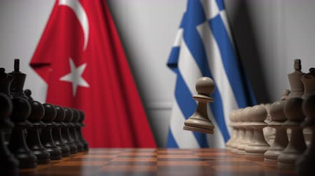 turk : Flags of Turkey and Greece behind pawns on the chessboard. Chess game or political rivalry related 3D animation