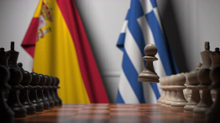 spaniard : Flags of Spain and Greece behind pawns on the chessboard. Chess game or political rivalry related 3D animation