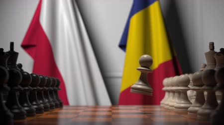 roumaine : Flags of Poland and Romania behind pawns on the chessboard. Chess game or political rivalry related 3D animation Vidéos Libres De Droits