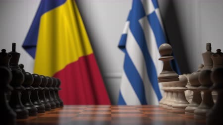 greek flag : Flags of Romania and Greece behind pawns on the chessboard. Chess game or political rivalry related 3D animation