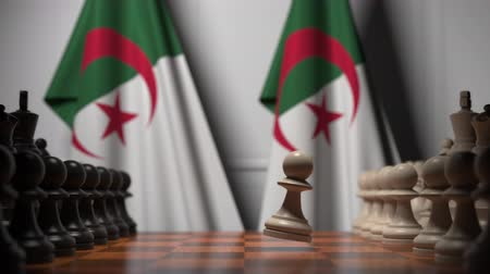 meetings : Flags of Algeria behind pawns on the chessboard. Chess game or political rivalry related 3D animation