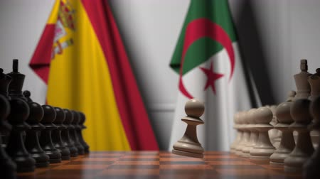 algeria : Flags of Spain and Algeria behind pawns on the chessboard. Chess game or political rivalry related 3D animation