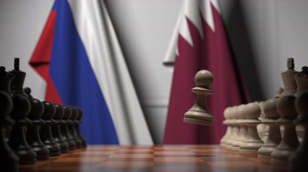 xadrez : Flags of Russia and Qatar behind pawns on the chessboard. Chess game or political rivalry related 3D animation