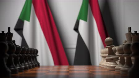 soedan : Chess game against flags of Sudan. Political competition related 3D animation Stockvideo