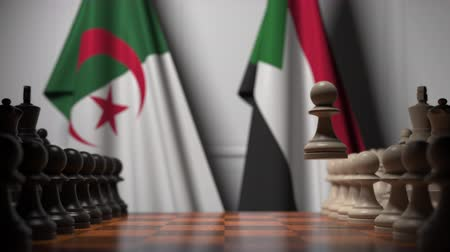 algeria : Flags of Algeria and Sudan behind pawns on the chessboard. Chess game or political rivalry related 3D animation