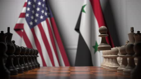 syrian : Flags of USA and Syria behind pawns on the chessboard. Chess game or political rivalry related 3D animation Stock Footage