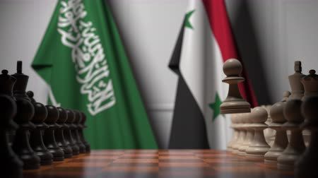 syrian : Flags of Saudi Arabia and Syria behind pawns on the chessboard. Chess game or political rivalry related 3D animation