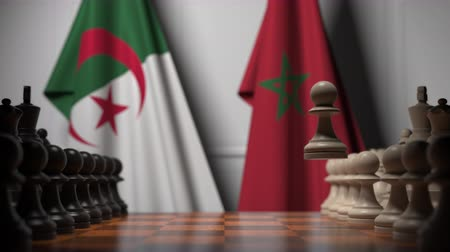 соперничество : Flags of Algeria and Morocco behind pawns on the chessboard. Chess game or political rivalry related 3D animation