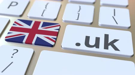 dominio : British domain .uk and flag of the UK on the buttons on the computer keyboard. National internet related 3D animation