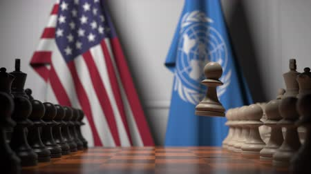 chessboard : Flags of USA and United Nations behind pawns on the chessboard. Conceptual editorial 3D animation Stock Footage