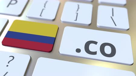 registrace : Colombian domain .co and flag of Colombia on the buttons on the computer keyboard. National internet related 3D animation
