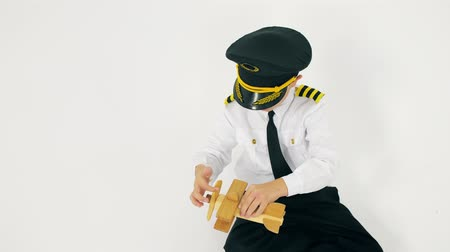 propeller toy : Boy in pilots uniform plays with a toy plane propeller