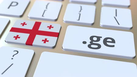 registrace : Georgian domain .ge and flag of Georgia on the buttons on the computer keyboard. National internet related 3D animation