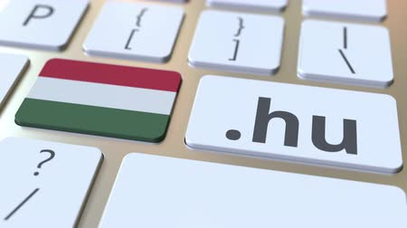 doména : Hungarian domain .hu and flag of Hungary on the buttons on the computer keyboard. National internet related 3D animation