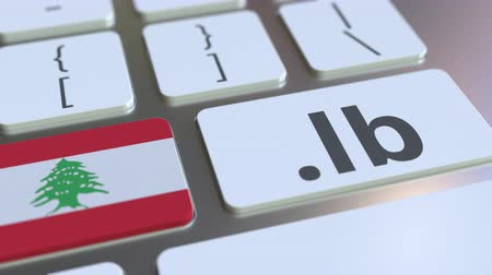 libra : Lebanese domain .lb and flag of Lebanon on the buttons on the computer keyboard. National internet related 3D animation Vídeos