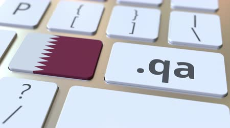 doména : Qatari domain .qa and flag of Qatar on the buttons on the computer keyboard. National internet related 3D animation