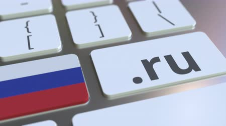 doména : Russian domain .ru and flag of Russia on the buttons on the computer keyboard. National internet related 3D animation