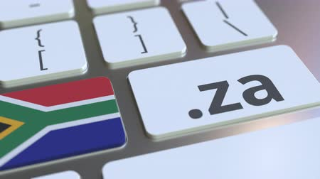 doména : Domain .za and flag of South Africa on the buttons on the computer keyboard. National internet related 3D animation