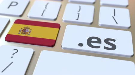 ações : Spanish domain .es and flag of Spain on the buttons on the computer keyboard. National internet related 3D animation