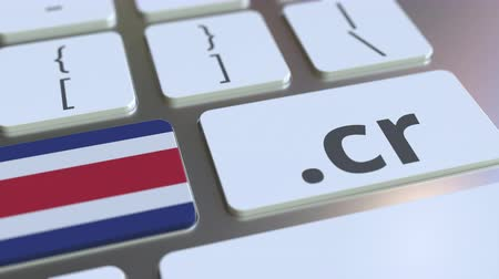 registrace : Domain .cr and flag of Costa Rica on the buttons on the computer keyboard. National internet related 3D animation Dostupné videozáznamy
