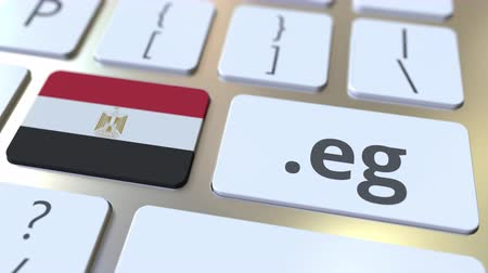 doména : Egyptian domain .ru and flag of Egypt on the buttons on the computer keyboard. National internet related 3D animation