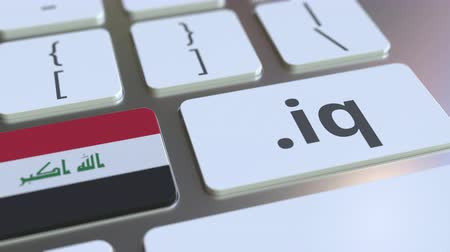 domein : Iraqi domain .iq and flag of Iraq on the buttons on the computer keyboard. National internet related 3D animation Stockvideo