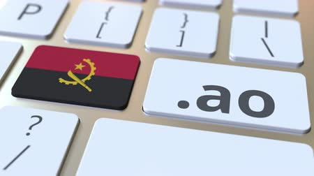 doména : Angolan domain .ao and flag of Angola on the buttons on the computer keyboard. National internet related 3D animation