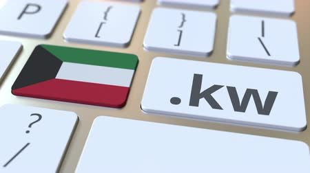 th : Kuwaiti domain .kw and flag of Kuwait on the buttons on the computer keyboard. National internet related 3D animation Stock Footage