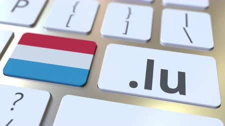 domein : Luxembourgian domain .lu and flag of Luxembourg on the buttons on the computer keyboard. National internet related 3D animation