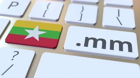register : Myanma domain .mm and flag of Myanmar on the buttons on the computer keyboard. National internet related 3D animation
