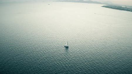 aerial athens : Aerial view of unknown sailing yacht at sea. Athens, Greece Stock Footage
