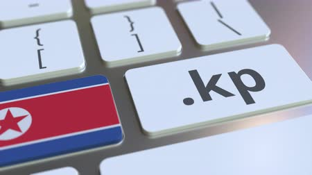адрес : Domain .kp and flag of North Korea on the buttons on the computer keyboard. National internet related 3D animation Стоковые видеозаписи