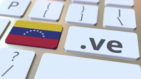 адрес : Venezuelan domain .ve and flag of Venezuela on the buttons on the computer keyboard. National internet related 3D animation Стоковые видеозаписи