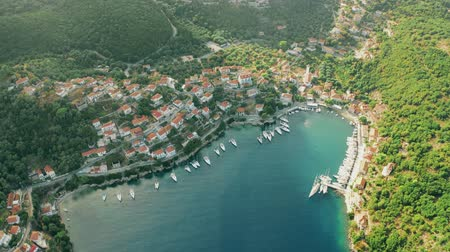 docked : Aerial shot of beautiful town of Kioni and harbour. Ithaca island located in the Ionian Sea, Greece