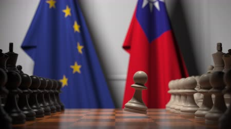 leden : Flags of EU and Taiwan behind pawns on the chessboard. Chess game or political rivalry related 3D animation