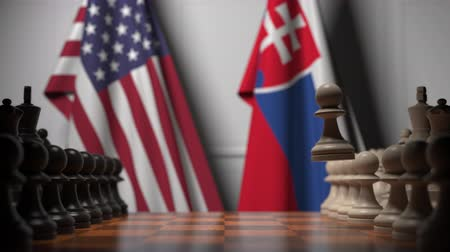 Словакия : Flags of USA and Slovakia behind pawns on the chessboard. Chess game or political rivalry related 3D animation