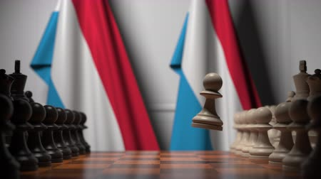oposição : Chess game against flags of Luxembourg. Political competition related 3D animation