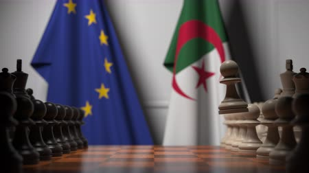 algeria : Flags of EU and Algeria behind pawns on the chessboard. Chess game or political rivalry related 3D animation