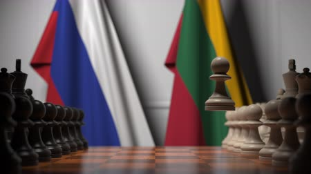 flag of lithuania : Flags of Russia and Lithuania behind pawns on the chessboard. Chess game or political rivalry related 3D animation