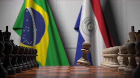brazil : Flags of Brazil and Paraguay behind pawns on the chessboard. Chess game or political rivalry related 3D animation