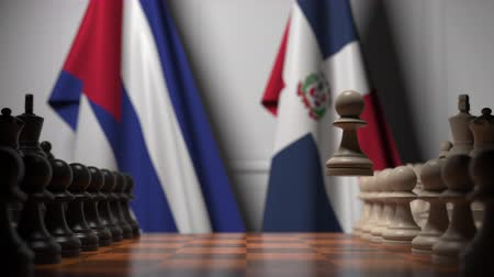 cubano : Flags of Cuba and Dominican Republic behind pawns on the chessboard. Chess game or political rivalry related 3D animation