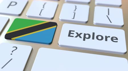 タンザニア : EXPLORE word and national flag of Tanzania on the buttons of the keyboard. 3D animation