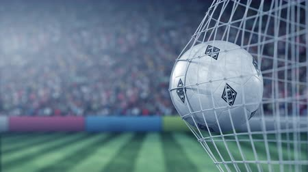 得点 : Ball with Borussia Monchengladbach football club logo hits football goal net. Conceptual editorial 3D animation
