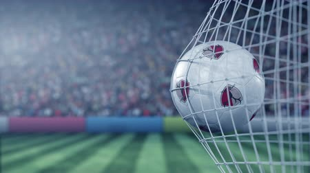agancs : Ball with Kashima Antlers football club logo hits football goal net. Conceptual editorial 3D animation