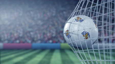 арена : Ball with Real Sociedad football club logo hits football goal net. Conceptual editorial 3D animation Стоковые видеозаписи